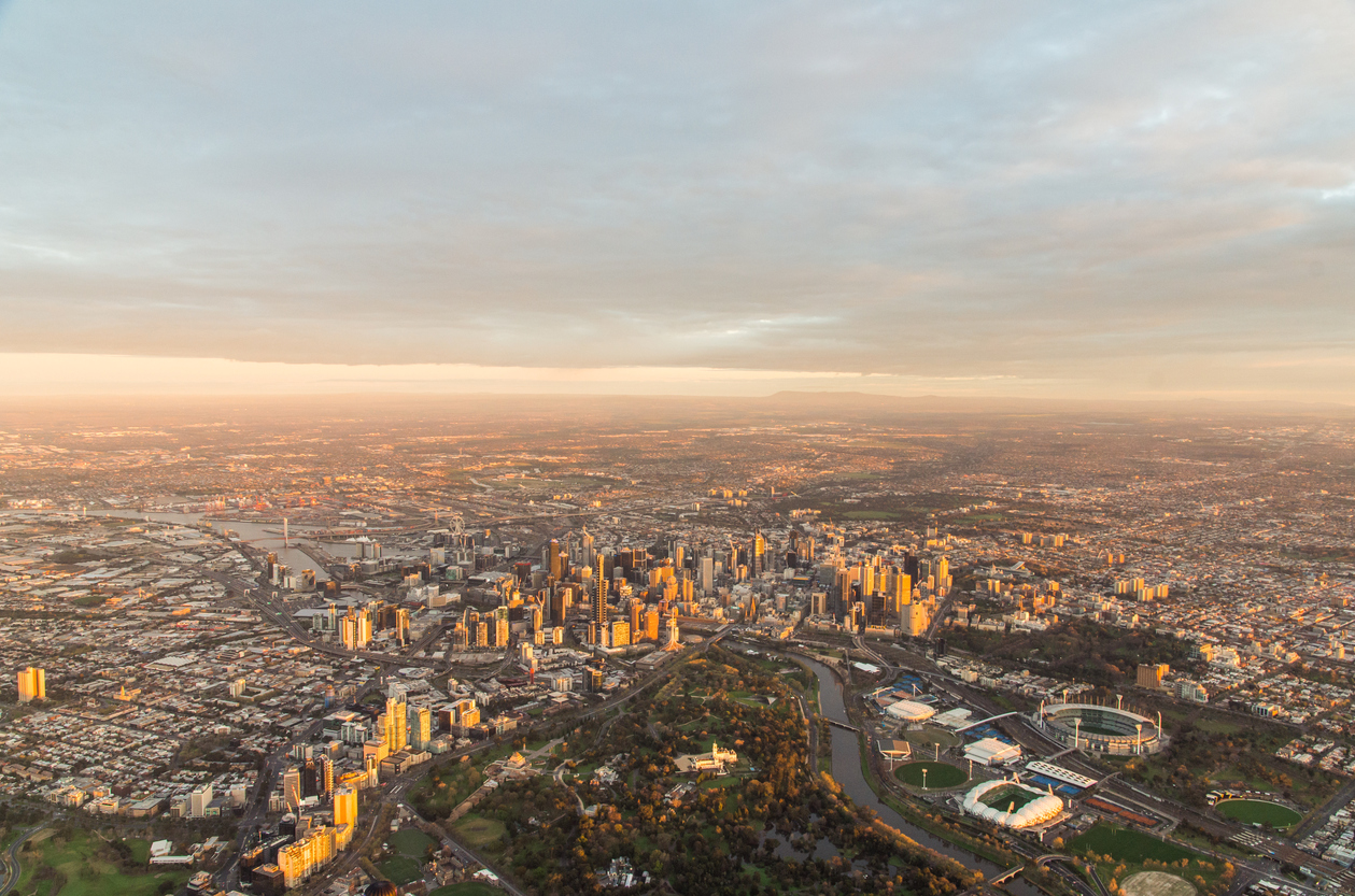 15 September 2013 - aerial view of Melbourne central business district and inner suburbs, at dawn from a hot air balloon, showing the Royal Botanic Garden, Melbourne Cricket Ground, Yarra River and Melbourne skyline.